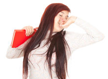 Yawning girl with red book Royalty Free Stock Images