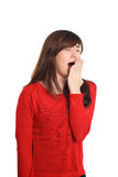 Yawning Girl in red with tired gesture Stock Images