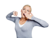 Yawning girl stretches herself Royalty Free Stock Photo