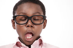 Yawning kid Stock Photos