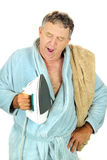 Yawning Man With Iron Stock Image