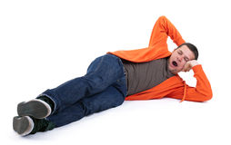 Yawning man lying with head on palm Royalty Free Stock Photography