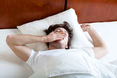 Yawning man in the morning Stock Photo