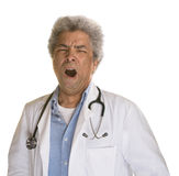 Yawning Mature Doctor Royalty Free Stock Image