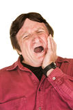 Yawning Mature Man Stock Photography