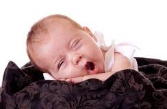 Yawning newborn Stock Image