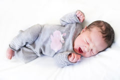 Yawning newborn baby girl - just several hours old Royalty Free Stock Image