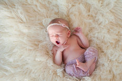 Yawning Newborn Baby Girl Stock Images