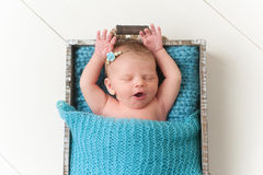 Yawning Newborn Baby Girl Stock Photo