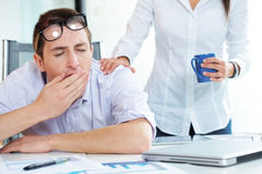 Yawning in the office Royalty Free Stock Image