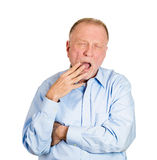 Yawning older man Royalty Free Stock Photo
