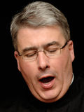 Yawning priest Royalty Free Stock Images