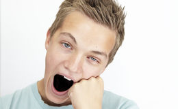 Yawning schoolboy Stock Photo