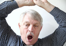 Yawning senior man Stock Photography