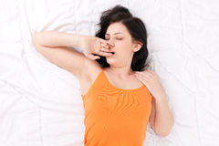 Yawning stretching woman Royalty Free Stock Images
