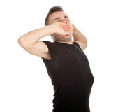 Yawning and stretching young man Royalty Free Stock Photography