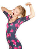 Yawning and stretching young woman Royalty Free Stock Photo
