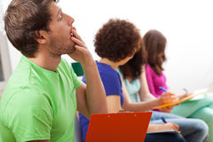 Yawning student during lecture. Yawning male student during boring lecture at university Royalty Free Stock Photography