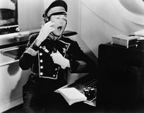 Yawning switchboard operator Stock Image