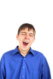 The yawning teenager. Isolated on the white Stock Photography