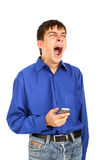 Yawning teenager. With mobile phone isolated on the white Royalty Free Stock Photography