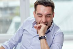 Yawning tired man at home or office Stock Photos
