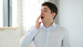 Yawning Tired Man, Indoor. High quality Stock Photos
