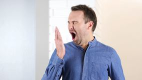 Yawning Tired Middle Aged Man royalty free stock photo