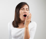 Yawning tired woman Stock Image