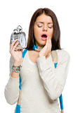 Yawning woman with alarm clock Royalty Free Stock Photo