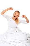 Yawning woman in bedroom Stock Photo