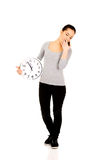 Yawning woman with a clock. Royalty Free Stock Photos