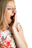 Yawning woman i Stock Images