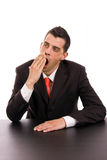 Yawning young business man Royalty Free Stock Photos