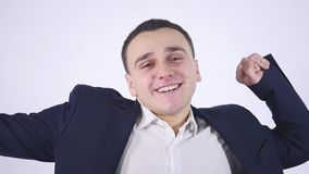 Yawning young business man, isolated on white background stock video