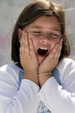 Yawning young girl Stock Photography