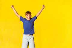 Yay! The happiness beautiful boy celebrates the victory Royalty Free Stock Photo