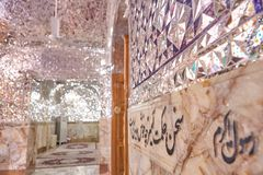 Calligraphic inscription on wall of mosque, quote from Koran, Ir. Yazd, Iran - April 22, 2017: The walls of the mirror mosque, decorated with quotes from the Stock Photos