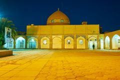 The mosque of Masalla and Mirka Bik. YAZD, IRAN - OCTOBER 17, 2017: The courtyard of mosque of Masalla and Mirka Bik in the evening lights, on October 17 in Yazd Stock Image