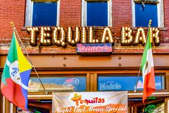 Tequila Bar and Colorful flags in 7th Ave. stock image