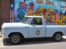 Ybor City, Tampa, Florida. Ford F100 pick up truck with mock logo on door: Dysfunctional Grace.  Parked on 7th Avenue in Ybor City, Tampa, in front of Viva Ybor stock photo
