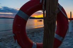 Życia boja morzem przy zmierzchem Zdjęcie Stock