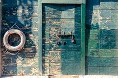 Życia boja na starym drewnianym kasetonowym tle Zdjęcie Stock