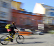 Сyclist in motion going down the street Royalty Free Stock Images