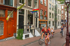 Сyclists on the street in Amsterdam Stock Images
