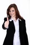 Życzliwa biznesowa kobieta z wali up Obrazy Royalty Free
