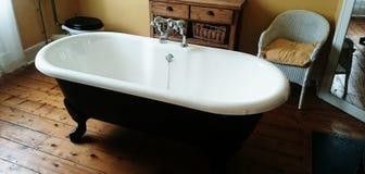 Ye old bath. Vintage Roll top bath Royalty Free Stock Photography