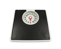 Ye Old Scale. Old, worn bathroom scale ready to deliver the news Stock Photos