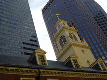 Ye Olde Meeting House Boston Massachusetts. Old meeting house from early america in foreground with modern skyscrapers in background, taken in the morning Stock Images