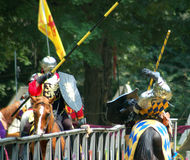 Ye Royal Joust. Knight being knocked off his horse Stock Image